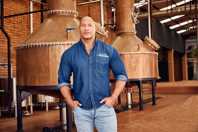 This photo provided by Jesus Maria shows Dwayne Johnson, co-founder of Teremana Tequila at the Teremana tequila distillery in Jalisco, Mexico. Johnson joins a list of celebrities including George Clooney, Nick Jonas and Kendall Jenner with their own tequila brands. (Jesus Maria via AP)