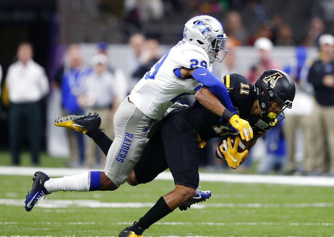 Appalachian State wide receiver Jalen Virgil (11) is tackled by Middle Tennessee cornerback Darryl Randolph (29) on a 35-yard pass completion in the first half of the New Orleans Bowl NCAA college football game in New Orleans, Saturday, Dec. 15, 2018. (AP Photo/Gerald Herbert)