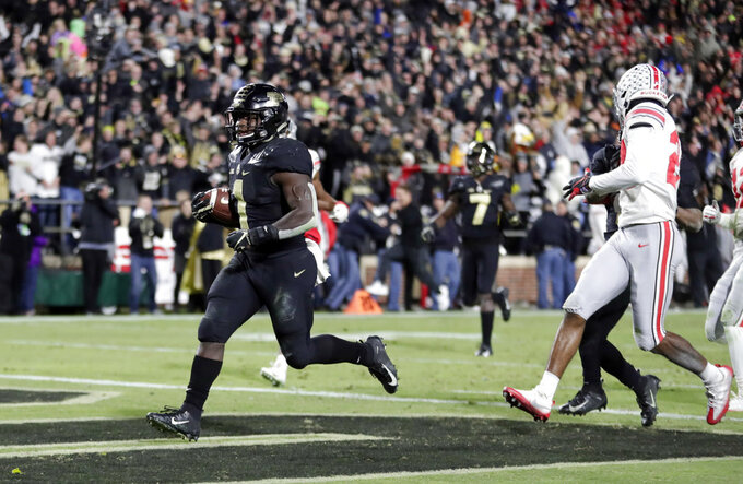 Purdue running back D.J. Knox (1) scores a touchdown against Ohio State during the second half of an NCAA college football game in West Lafayette, Ind., Saturday, Oct. 20, 2018. Purdue defeated Ohio State 49-20. (AP Photo/Michael Conroy)