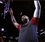 Miami Heat guard Dwyane Wade acknowledges the crowd before the team's NBA basketball game against the Brooklyn Nets, Wednesday, April 10, 2019, in New York. Wade is retiring after the game. (AP Photo/Kathy Willens)