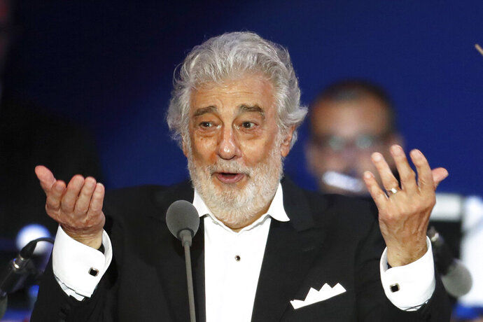 FILE - In this Aug. 28, 2019, file photo, opera star Placido Domingo performs during a concert in Szeged, Hungary. Domingo is scheduled to sing two concert performances in Verdi's