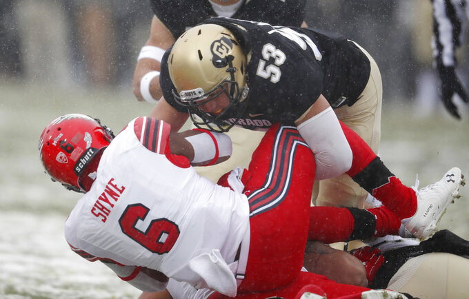 Colorado linebacker Nate Landman, back, tackles Utah running back Armand Shyne after a short gain in the first half of an NCAA college football game Saturday, Nov. 17, 2018, in Boulder, Colo. (AP Photo/David Zalubowski)