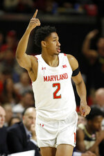 Maryland guard Aaron Wiggins reacts after hitting a 3-pointer against Purdue during the first half of an NCAA college basketball game, Saturday, Jan. 18, 2020, in College Park, Md. (AP Photo/Julio Cortez)