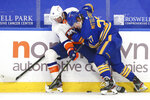 Buffalo Sabres forward Casey Mittelstadt (37) and New York Islanders forward Travis Zajac (14) battle for the puck during the second period of an NHL hockey game, Tuesday, May 4, 2021, in Buffalo, N.Y. (AP Photo/Jeffrey T. Barnes)