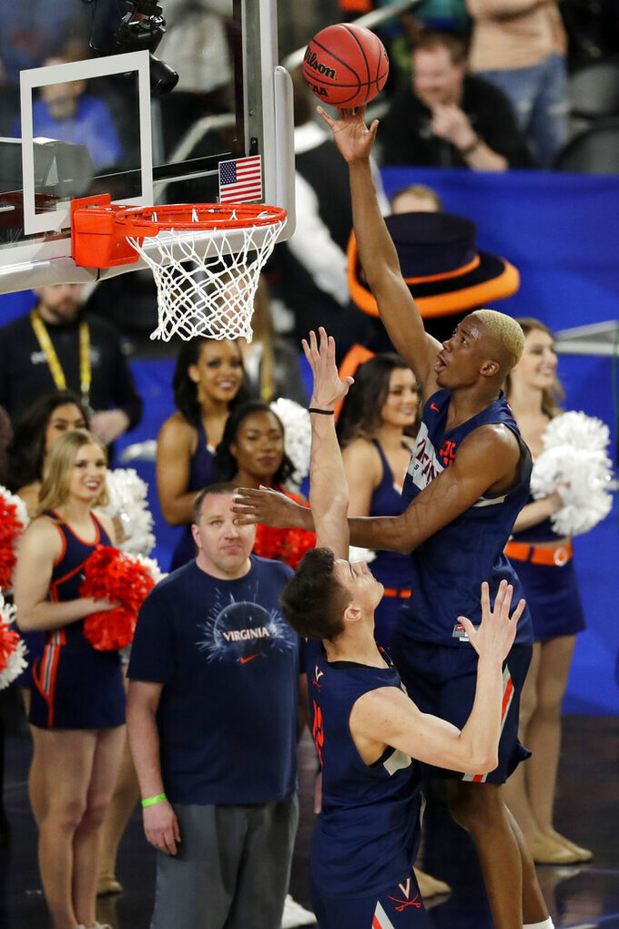 Virginia's Mamadi Diakite (25) shoots over Francisco Caffaro (22) during a practice session for the semifinals of the Final Four NCAA college basketball tournament, Friday, April 5, 2019, in Minneapolis. (AP Photo/Matt York)