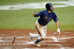 Tampa Bay Rays' Brandon Lowe reacts after hitting a solo home run off Washington Nationals relief pitcher Daniel Hudson during the ninth inning of a baseball game Wednesday, Sept. 16, 2020, in St. Petersburg, Fla. (AP Photo/Chris O'Meara)
