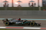 Mercedes driver Lewis Hamilton of Britain in action during the Formula One race at the Yas Marina racetrack in Abu Dhabi, United Arab Emirates, Sunday, Dec.13, 2020. (Hamad Mohammed, Pool via AP)
