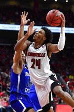 Louisville forward Dwayne Sutton (24) looks for a shot as Indiana State guard Tyreke Key (11) defends during the second half of an NCAA college basketball game in Louisville, Ky., Wednesday, Nov. 13, 2019. Louisville won 91-62. (AP Photo/Timothy D. Easley)