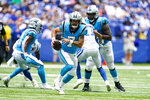 Carolina Panthers quarterback Will Grier (7) scrambles against the Indianapolis Colts during the second half of an NFL exhibition football game in Indianapolis, Sunday, Aug. 15, 2021. (AP Photo/Michael Conroy)