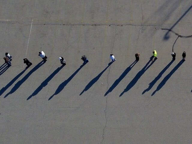 People line up to vote at the Milwaukee County Sports Complex Tuesday, Nov. 3, 2020, in Franklin, Wis. (AP Photo/Morry Gash)