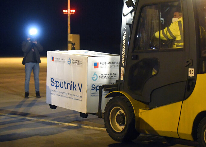"""FILE - In this March 1, 2021, file photo, Russia's Sputnik V coronavirus vaccine arrives at Kosice Airport, Slovakia. Russia's boast in August that it was the first country to authorize a coronavirus vaccine led to skepticism because of its insufficient testing on only a few dozen people. Slovakia's government is still set to discuss possible use of Sputnik V with Russia after the coronavirus vaccine was successfully tested in a Hungarian lab. Slovakia's Health Minister Vladimir Lengvarsky said he will talk with his country's experts and """"the Russian side about the further development on this issue."""" (Frantisek Ivan/TASR via AP, File)"""