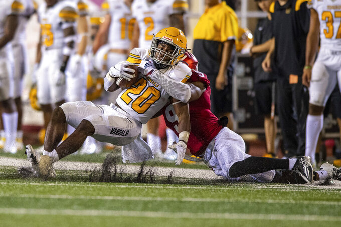 Idaho wide receiver Christian Niemela (20) is tackled by Indiana defensive back Marcelino McCrary-Ball (9) during the second half of an NCAA college football game Saturday, Sept. 11, 2021, in Bloomington, Ind. (AP Photo/Doug McSchooler)