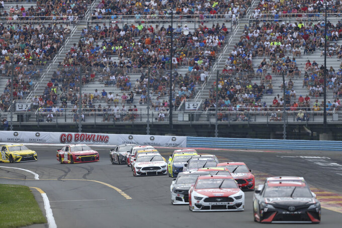Cars drive through Turn 1 during a NASCAR Cup Series auto race in Watkins Glen, N.Y., on Sunday, Aug. 8, 2021. (AP Photo/Joshua Bessex)