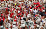 Members of the Bolivarian Militia raise their hands swearing allegiance to the fatherland at a rally in Caracas, Venezuela, Saturday, Feb. 2, 2019. Venezuela's President Nicolas Maduro called the rally to celebrate the 20th anniversary of the Chavez's rise to power. (AP Photo/Ariana Cubillos)
