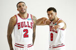 Chicago Bulls' Zach LaVine (8) clowns around as he poses for a photo with Lonzo Ball during the Bulls' NBA basketball media day Monday, Sept. 27, 2021, in Chicago. (AP Photo/Charles Rex Arbogast)