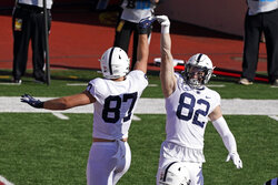Penn State's Pat Freiermuth (87) and Zack Kuntz (82) celebrate a touchdown Freiermuth during the first half of an NCCAA college football game against Indiana, Saturday, Oct. 24, 2020, in Bloomington, Ind. (AP Photo/Darron Cummings)