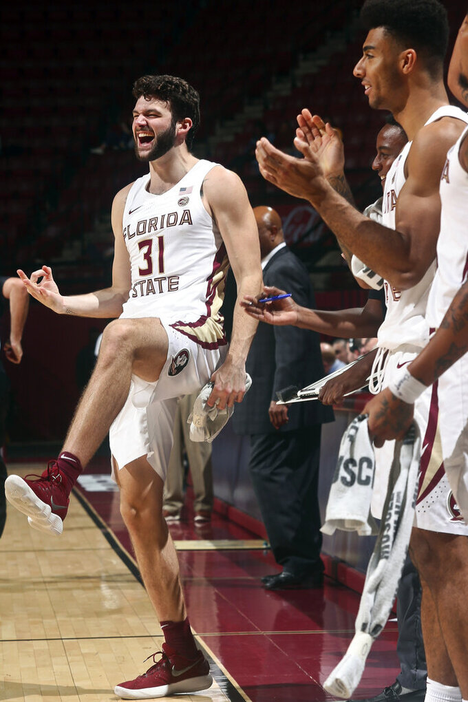 Florida State forward Wyatt Wilkes (31) reacts after a 3-point basket in the second half of an NCAA college basketball game against North Florida in Tallahassee, Fla., Tuesday, Dec. 17, 2019. Florida State won 98-81. (AP Photo/Phil Sears)