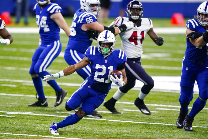 Indianapolis Colts running back Nyheim Hines (21) runs against the Houston Texans in the first half of an NFL football game in Indianapolis, Sunday, Dec. 20, 2020. (AP Photo/Darron Cummings)