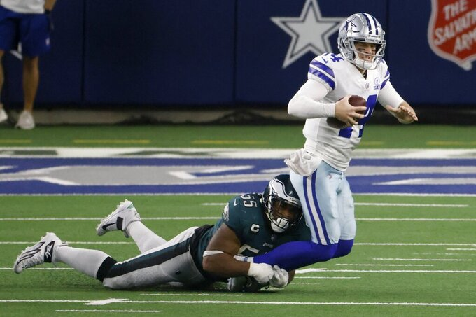 Philadelphia Eagles defensive end Brandon Graham (55) dives to stop Dallas Cowboys quarterback Andy Dalton (14) as he scrambles out of the pocket in the second half of an NFL football game in Arlington, Texas, Sunday, Dec. 27. 2020. (AP Photo/Ron Jenkins)