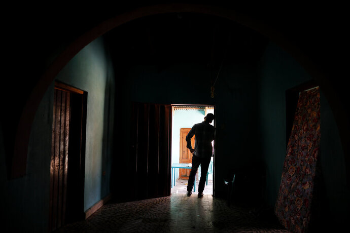 In this Aug. 23, 2019, photo, a Honduran father stands at his home in Comayagua, Honduras, after talking in an interview about being separated from his 3-year-old daughter at the border after traveling for weeks to seek asylum in the U.S. According to court records, his daughter was sexually abused in U.S. foster care. She was later deported and arrived back in Honduras withdrawn, anxious and angry. He fears their bond is forever broken. (AP Photo/Elmer Martinez)