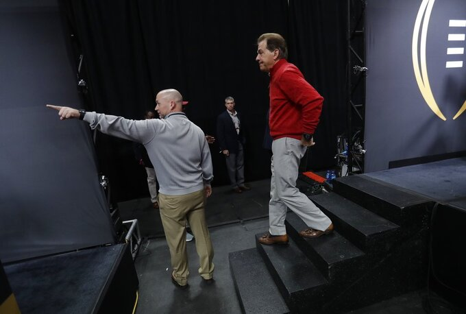 Alabama head coach Nick Saban walks off his platform after media day for the NCAA college football playoff championship game Saturday, Jan. 5, 2019, in Santa Clara, Calif. (AP Photo/David J. Phillip)