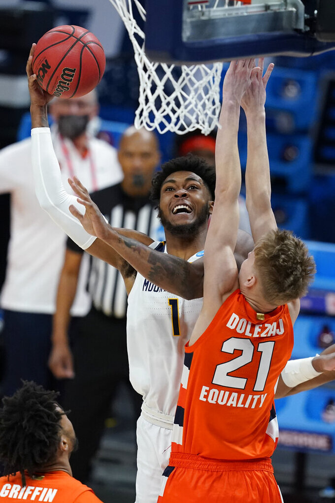 West Virginia's Derek Culver (1) shoots over Syracuse's Marek Dolezaj (21) during the first half of a second-round game in the NCAA men's college basketball tournament at Bankers Life Fieldhouse, Sunday, March 21, 2021, in Indianapolis. (AP Photo/Darron Cummings)