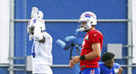 Buffalo Bills wide receiver Stefon Diggs (14) cheers on his teammates as they stretch during NFL football practice in Orchard Park, N.Y., Thursday, Sept. 3, 2020. (James P. McCoy/The Buffalo News via AP, Pool)