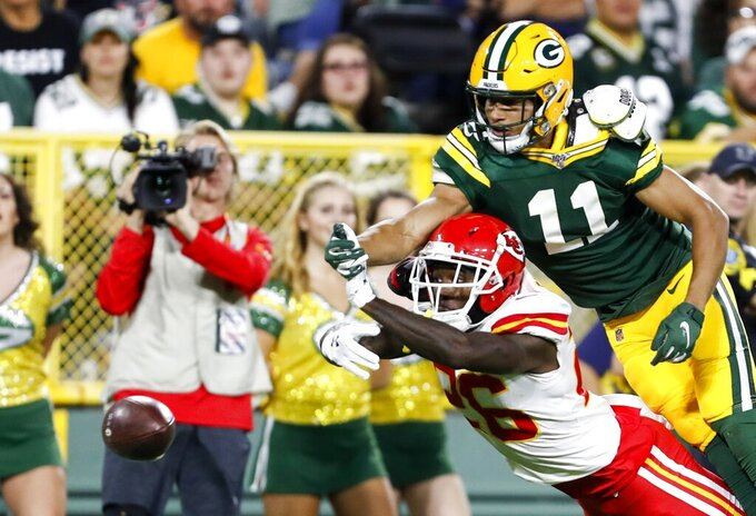 Green Bay Packers' Trevor Davis breaks up a pass intended for Kansas City Chiefs' Damien Williams during the first half of a preseason NFL football game Thursday, Aug. 29, 2019, in Green Bay, Wis. (AP Photo/Matt Ludtke)