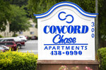 This Monday, June 14, 2021 photo shows a sign for the apartment complex in Smyrna, Ga., where Johnny Lorenzo Bolton was shot in December by the Cobb County Sheriff's Office SWAT team. Bolton was on a couch in his apartment near Atlanta \ when police serving a narcotics search warrant burst through the front door with no warning. A lawyer for the family says that when the 49-year-old Bolton stood up from the couch, at least one of the officers fired, hitting him with two bullets. (AP Photo/Mike Stewart)