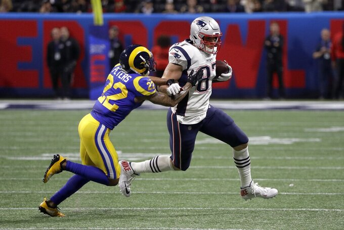 Los Angeles Rams' Marcus Peters, left, chases New England Patriots' Rob Gronkowski during the first half of the NFL Super Bowl 53 football game Sunday, Feb. 3, 2019, in Atlanta. (AP Photo/David J. Phillip)