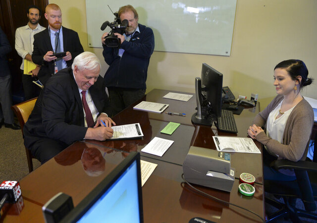 West Virginia Governor Jim Justice files his candidacy papers for reelection along with President Trump's reelection papers Thursday, Jan, 16, 2020, in the West Virginia Secretary of State's office at the West Virginia State Capitol in Charleston, W.V. (Kenny Kemp/Charleston Gazette-Mail via AP)