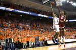 Alabama guard John Petty Jr. (23) defends a shot by Auburn guard J'Von McCormick (5) during overtime of an NCAA college basketball game, Wednesday, Feb. 12, 2020, in Auburn, Ala. (AP Photo/Julie Bennett)