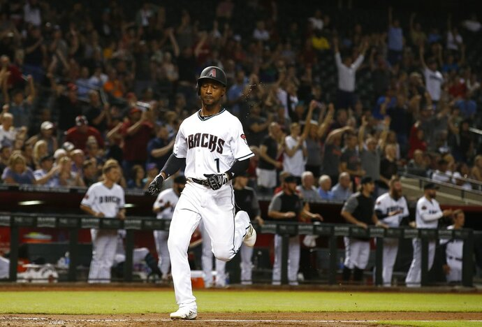 Arizona Diamondbacks' Jarrod Dyson runs home to score against the Milwaukee Brewers during the eighth inning of a baseball game Tuesday, May 15, 2018, in Phoenix. The Diamondbacks won 2-1. (AP Photo/Ross D. Franklin)