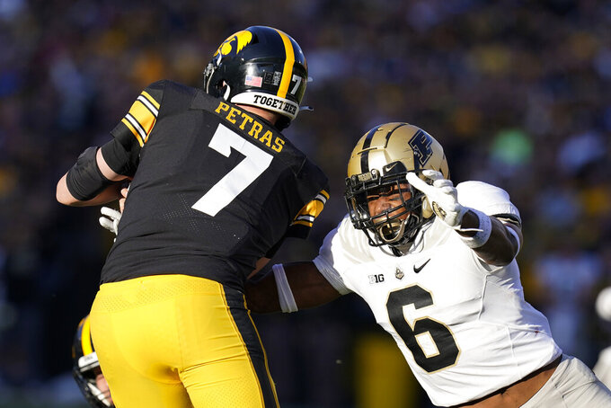 Purdue linebacker Jalen Graham (6) tackles Iowa quarterback Spencer Petras (7) during the second half of an NCAA college football game, Saturday, Oct. 16, 2021, in Iowa City, Iowa. Purdue won 24-7. (AP Photo/Charlie Neibergall)