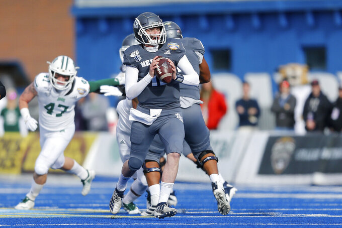 Nevada quarterback Carson Strong (12) moves up in the pocket looking downfield against Ohio in the first half of the Famous Idaho Potato Bowl an NCAA college football game Friday, Jan. 3, 2020, in Boise, Idaho. (AP Photo/Steve Conner)