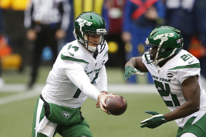 New York Jets quarterback Sam Darnold (14) hands off to running back Frank Gore during the first half of an NFL football game, Sunday, Dec. 13, 2020, in Seattle. (AP Photo/Lindsey Wasson)