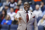 North Carolina Central coach LeVelle Moton points during the first half of the team's First Four game of the NCAA men's college basketball tournament against North Dakota State, Wednesday, March 20, 2019, in Dayton, Ohio. (AP Photo/John Minchillo)