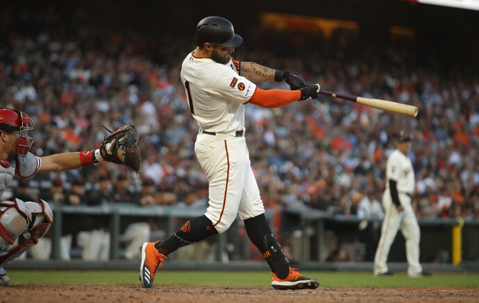 San Francisco Giants' Kevin Pillar swings for an RBI triple off Philadelphia Phillies' Nick Pivetta in the eighth inning of a baseball game Sunday, Aug. 11, 2019, in San Francisco. (AP Photo/Ben Margot)