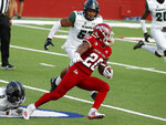 Fresno State running back Ronnie Rivers picks up a long gain against Hawaii linebacker Darius Muasau during the first half of an NCAA college football game in Fresno, Calif., Saturday, Oct. 24, 2020. (AP Photo/Gary Kazanjian)