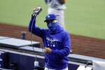 Los Angeles Dodgers right fielder Mookie Betts gestures as the Dodgers play the San Diego Padres during the second inning of a baseball game Wednesday, Aug. 5, 2020, in San Diego. (AP Photo/Gregory Bull)
