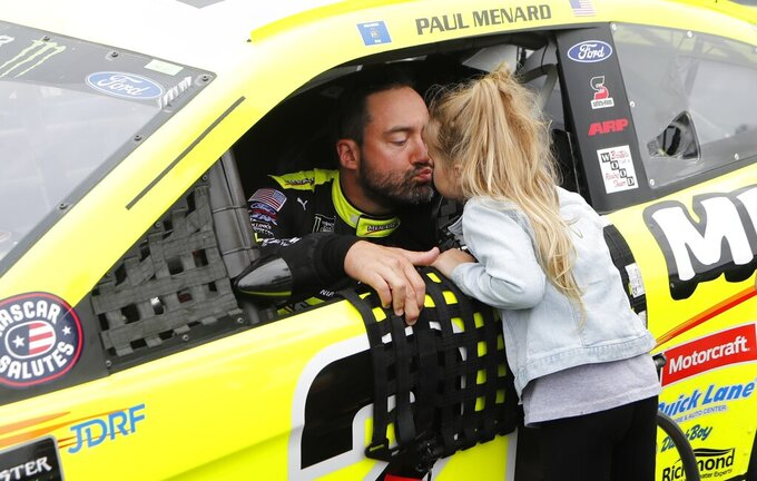 Paul Menard receives a kiss from his daughter Remi before the NASCAR cup series auto race at Michigan International Speedway, Sunday, June 9, 2019, in Brooklyn, Mich. (AP Photo/Carlos Osorio)