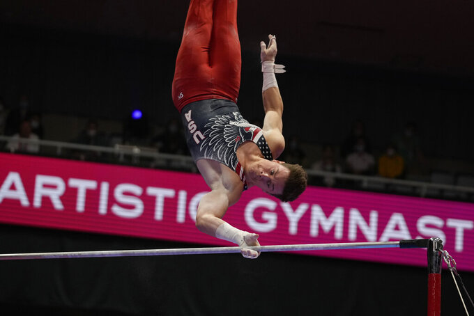 Brody Malone, of the U.S., competes in the horizontal bar during the men's apparatus finals of the FIG Artistic Gymnastics World Championships in Kitakyushu, western Japan, Sunday, Oct. 24, 2021. (AP Photo/Hiro Komae)