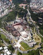 This aerial view shows the burnt-out main temple, center, of Shuri Castle in Naha, Okinawa, southern Japan, Thursday, Oct. 31, 2019. A fire early Thursday burned down structures at Shuri Castle on Japan's southern island of Okinawa, nearly destroying the UNESCO World Heritage site. (Kyodo News via AP)