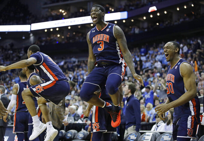 Auburn's Danjel Purifoy (3) and Austin Wiley (50) celebrate near the end of a men's NCAA tournament college basketball Midwest Regional semifinal game against North Carolina Friday, March 29, 2019, in Kansas City, Mo. (AP Photo/Charlie Riedel)
