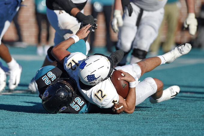 Coastal Carolina's CJ Brewer (52) sacks Appalachian State quarterback Zac Thomas during the second half of an NCAA college football game Saturday, Nov. 21, 2020, in Conway, S.C. Coastal Carolina won 34-23. (AP Photo/Richard Shiro)