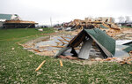 Severe storm damage to homes is seen on Plymouth Springmill Road just south of the intersection of Ohio Route 96 in Shelby, Ohio, Sunday, April 14, 2019. (Tom E. Puskar/The Times Gazette via AP)