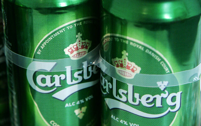 """FILE - This is a Friday, Jan. 25, 2008 file photo of Carlsberg beer cans at a joint press conference by Heineken and Carlsberg to announce their joint bid to buy UK brewer Scottish & Newcastle (S&N), in London Danish brewer Carlsberg said Thursday, Aug. 13, 2020,  its second quarter net profit dropped 7.3% to 2.9 billion kroner ($458 million) as all its markets were affected """"to a greater or lesser extent"""" by the global coronavirus outbreak. (AP Photo/Sang Tan, File)"""