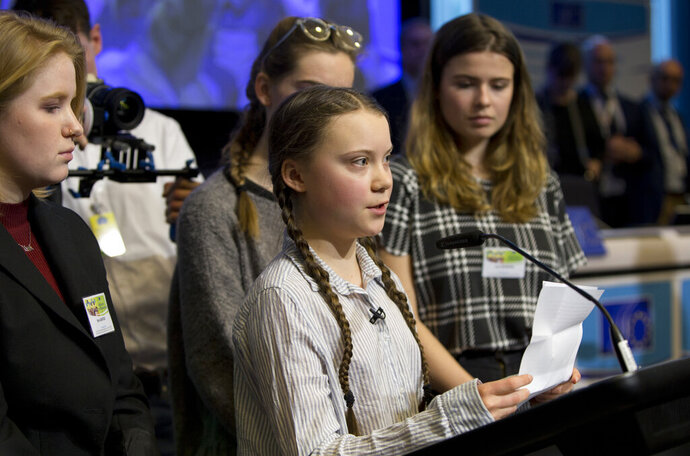 Swedish climate activist Greta Thunberg, center, speaks during an event at the EU Charlemagne building in Brussels, Thursday, Feb. 21, 2019. Thunberg will also participate in a climate march through the city later in the day. (AP Photo/Virginia Mayo)