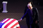 Former President Bill Clinton touches the flag-draped coffin of Rep. Elijah Cummings, D-Md., during his funeral service at the New Psalmist Baptist Church in Baltimore, Md., on Friday, Oct. 25, 2019. (Joshua Roberts/Pool via AP)