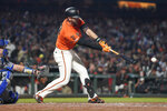 San Francisco Giants' Evan Longoria hits a single against the Los Angeles Dodgers during the fifth inning of a baseball game, Friday, Sept. 27, 2019, in San Francisco. (AP Photo/Tony Avelar)